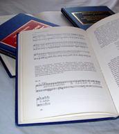 RMA monographs with open page at a music example