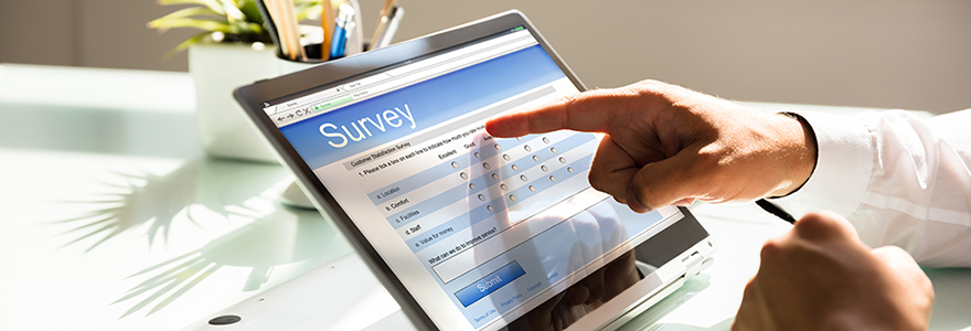 Finger pointing at an on-screen survey
