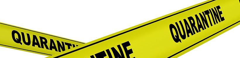 Yellow warning tape with Quarantine written on it