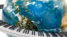 Photo of the earth surrounded by a piano keyboard