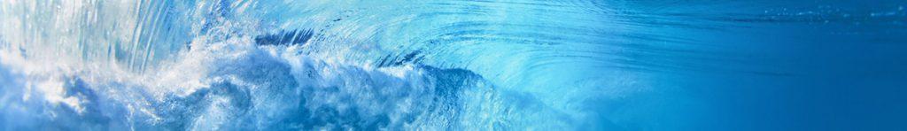 Underwater photo of ocean extreme wave breaking